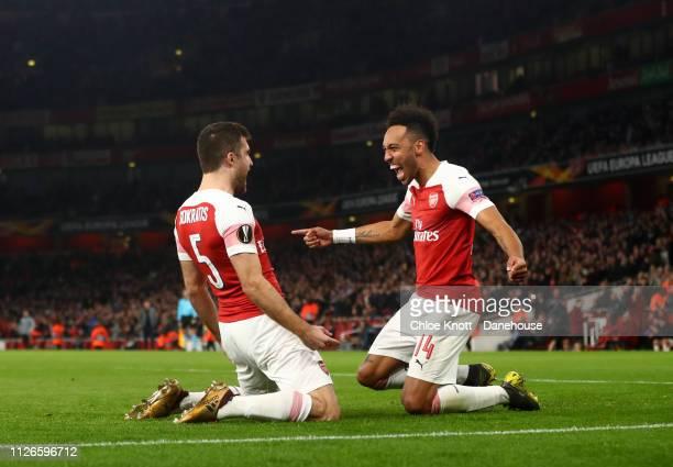Sokratis of Arsenal celebrates scoring his team third goal with PierreEmerick Aubameyang of Arsenal during the UEFA Europa League Round of 32 Second...