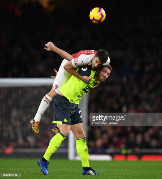 f9a82d58cfc Sokratis of Arsenal challenges Laurent Depoitre of Huddersfield during the  Premier League match between Arsenal FC