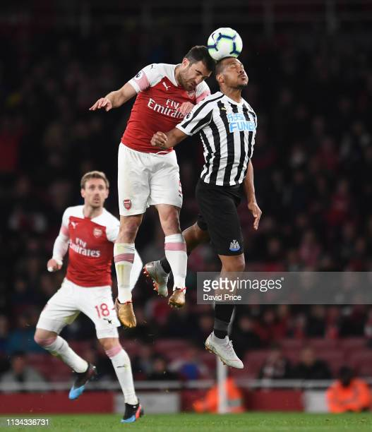 Sokratis of Arsenal challenges Salomon Rondon of Newcastle during the Premier League match between Arsenal FC and Newcastle United at Emirates...