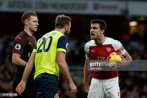 29f6548834d Sokratis of Arsenal clashes with Laurent Depoitre of Huddersfield Town  during the Premier League match between