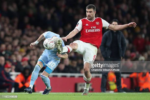 Sokratis of Arsenal comes close to kicking Ezgjan Alioski of Leeds in the head during the FA Cup Third Round match between Arsenal and Leeds United...