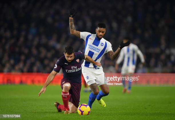 Sokratis of Arsenal is challenged by Jurgen Locadia of Brighton Hove Albion during the Premier League match between Brighton Hove Albion and Arsenal...