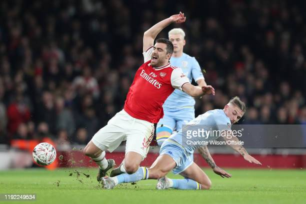 Sokratis of Arsenal is tackled by Kalvin Phillips of Leeds during the FA Cup Third Round match between Arsenal and Leeds United at Emirates Stadium...
