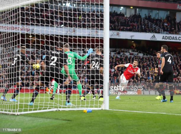 Sokratis of Arsenal scores the opening goal during the Premier League match between Arsenal FC and Crystal Palace at Emirates Stadium on October 27...