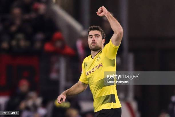 Sokratis of Borussia Dortmund celebrates after scoring his team's first goal to make it 01 during the Bundesliga match between 1 FSV Mainz 05 and...