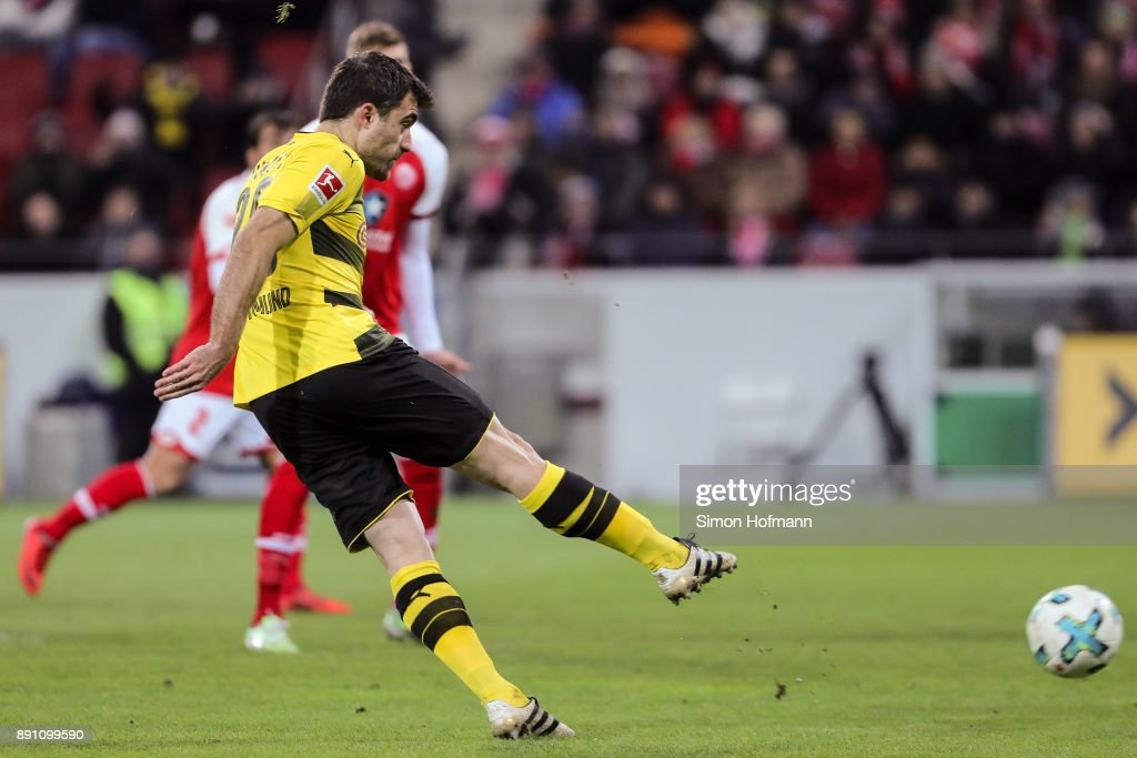 Sokratis #25 of Borussia Dortmund scores his team's first goal to make it 0-1 during the Bundesliga match between 1. FSV Mainz 05 and Borussia Dortmund at Opel Arena on December 12, 2017 in Mainz, Germany.