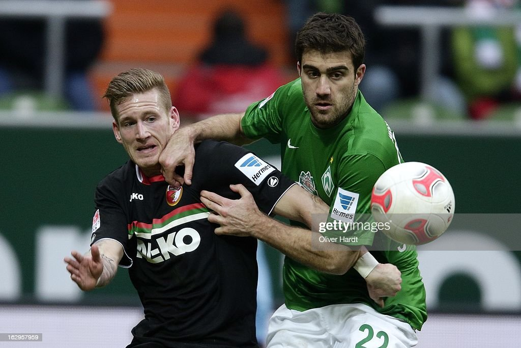 Sokratis (R) of Bremen and Andre Hahn (L) of Augsburg battle for the ball during the Bundesliga match between SV Werder Bremen and FC Augsburg at Weser Stadium on March 2, 2013 in Bremen, Germany.