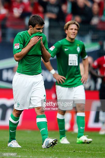 Sokratis of Bremen reacts after the 1 Bundesliga match between Hannover 96 and Werder Bremen at AWD Arena on September 15 2012 in Hannover Germany