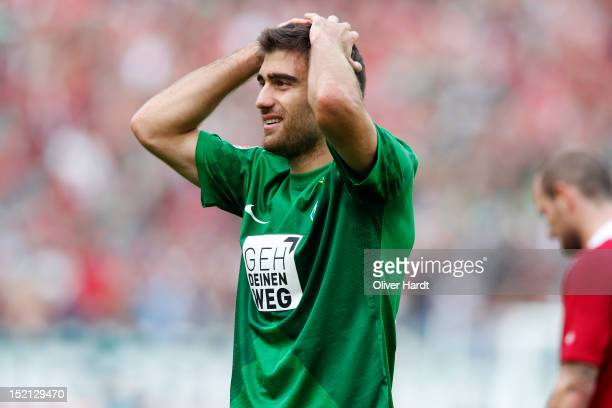 Sokratis of Bremen reacts during the Bundesliga match between Hannover 96 and Werder Bremen at AWD Arena on September 15 2012 in Hannover Germany