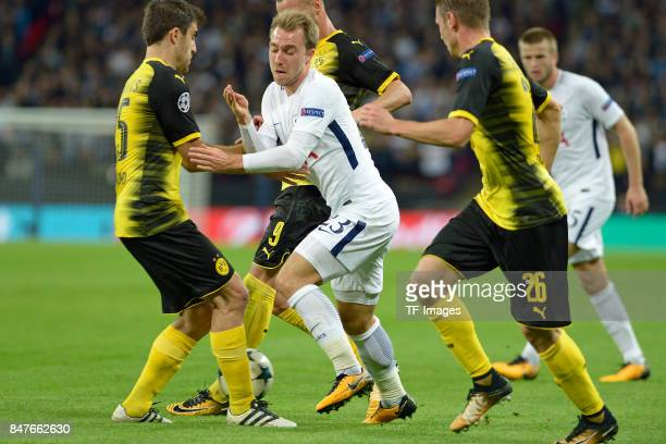 Sokratis of Dortmund and Andrey Yarmolenko of Dortmund and Christian Eriksen of Tottenham battle for the ball during the UEFA Champions League group...