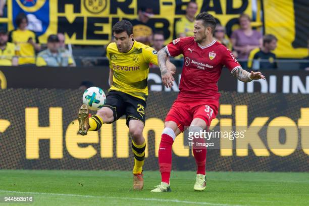Sokratis of Dortmund and Daniel Ginczek of Stuttgart battle for the ball during the Bundesliga match between Borussia Dortmund and VfB Stuttgart at...