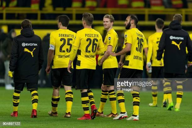 Sokratis of Dortmund Lukasz Piszczek of Dortmund Andre Schuerrle of Dortmund and Oemer Toprak of Dortmund look on after the Bundesliga match between...