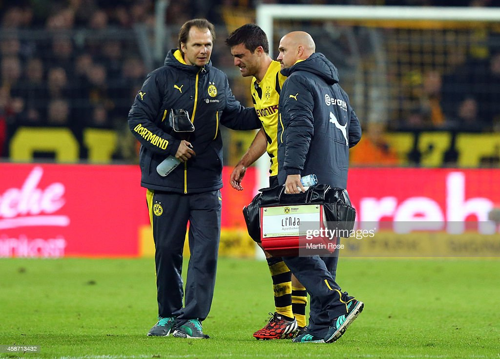 Sokratis of Dortmund walks injured off the pitch during the Bundesliga match between Borussia Dortmund and Borussia moenchengladbach at Signal Iduna Park on November 9, 2014 in Dortmund, Germany.
