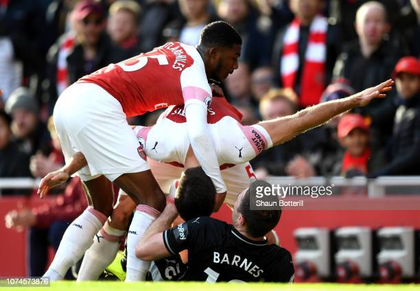Sokratis Papastathopoulos and Ainsley MaitlandNiles of Arsenal clash with Ashley Barnes of Burnley during the Premier League match between Arsenal FC...