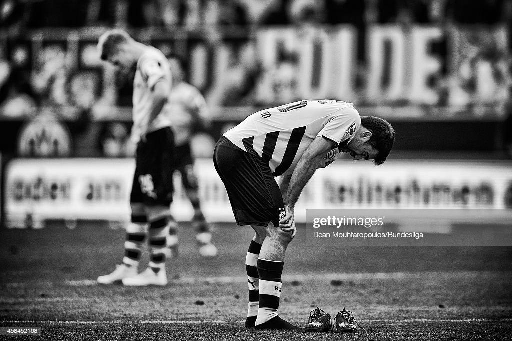 Sokratis Papastathopoulos and Lukasz Piszczek of Borussia Dortmund look dejected after defeat in the Bundesliga match between Borussia Dortmund and Hamburger SV at Signal Iduna Park on October 4, 2014 in Dortmund, Germany.
