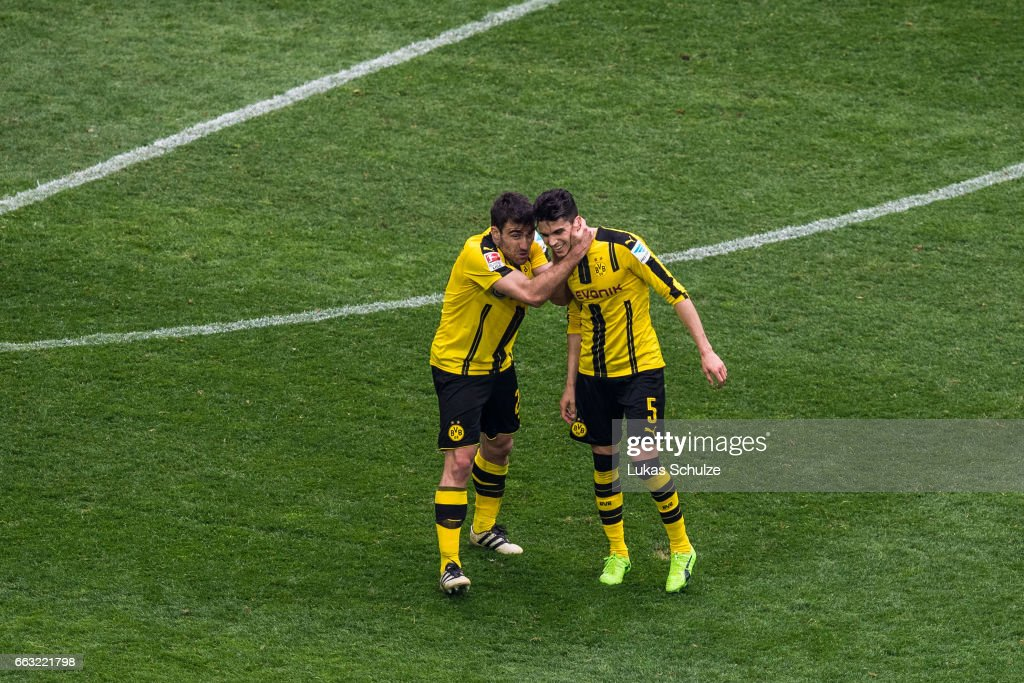 Sokratis Papastathopoulos (L) and Marc Bartra (R) of Dortmund react after the Bundesliga match between FC Schalke 04 and Borussia Dortmund at Veltins-Arena on April 1, 2017 in Gelsenkirchen, Germany.