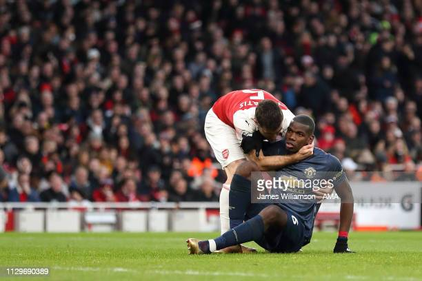 Sokratis Papastathopoulos of Arsenal and Paul Pogba of Manchester United during the Premier League match between Arsenal FC and Manchester United at...