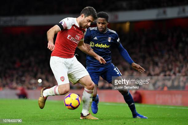 Sokratis Papastathopoulos of Arsenal and Ryan Sessegnon of Fulham during the Premier League match between Arsenal FC and Fulham FC at Emirates...