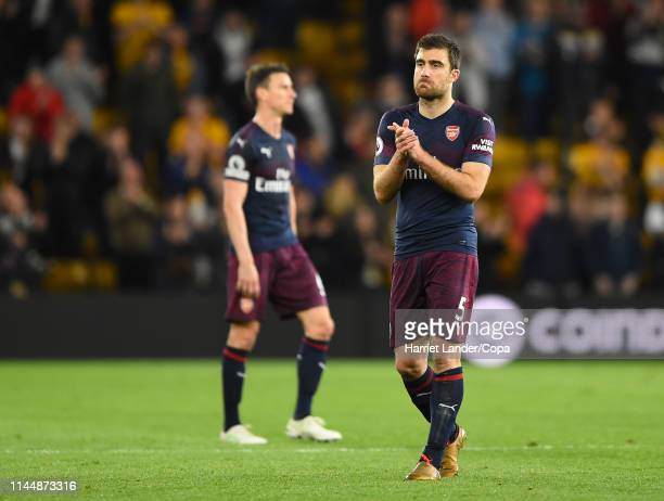 Sokratis Papastathopoulos of Arsenal applauds fans after the Premier League match between Wolverhampton Wanderers and Arsenal FC at Molineux on April...