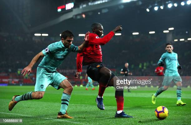 Sokratis Papastathopoulos of Arsenal battles for possession with Romelu Lukaku of Manchester United during the Premier League match between...