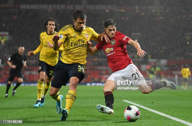 Sokratis Papastathopoulos of Arsenal battles for possession with Daniel James of Manchester United during the Premier League match between Manchester...