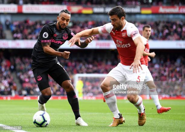 Sokratis Papastathopoulos of Arsenal battles for possession with Theo Walcott of Everton during the Premier League match between Arsenal FC and...