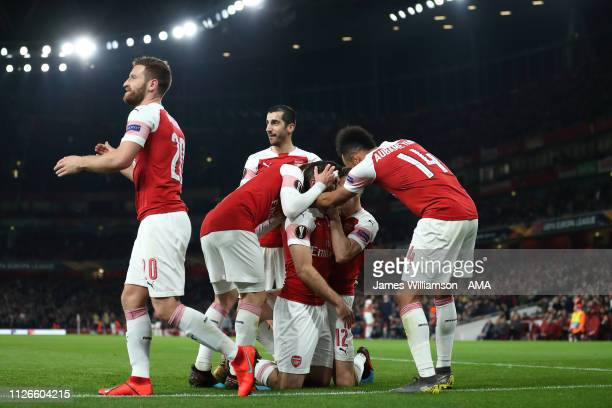 Sokratis Papastathopoulos of Arsenal celebrates after scoring a goal to make it 30 and 31 on Aggregate during the UEFA Europa League Round of 32...