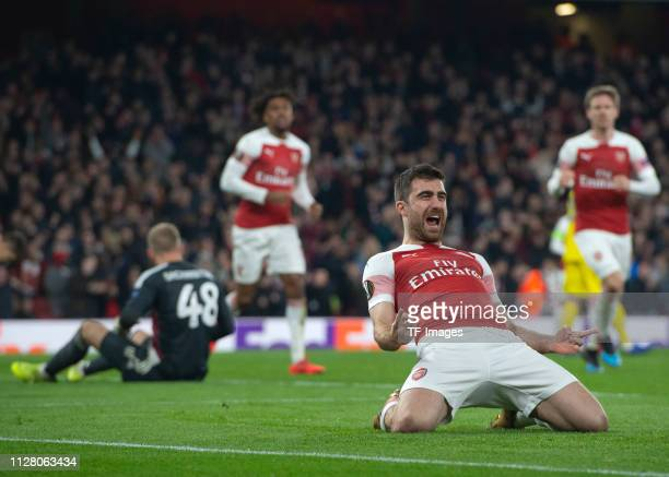 Sokratis Papastathopoulos of Arsenal celebrates after scoring during the UEFA Europa League Round of 32 Second Leg match between Arsenal and BATE...