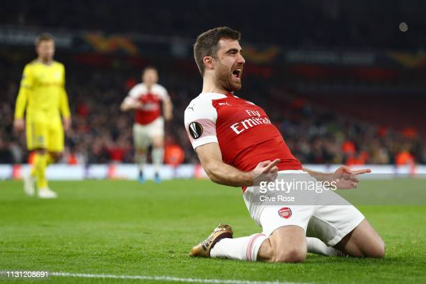 Sokratis Papastathopoulos of Arsenal celebrates after scoring his team's third goal during the UEFA Europa League Round of 32 Second Leg match...