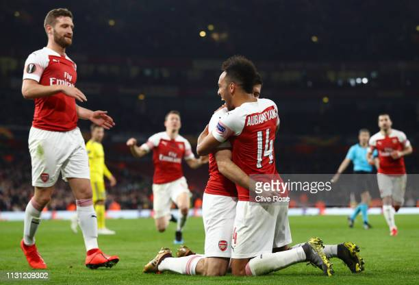 Sokratis Papastathopoulos of Arsenal celebrates after scoring his team's third goal with PierreEmerick Aubameyang of Arsenal during the UEFA Europa...