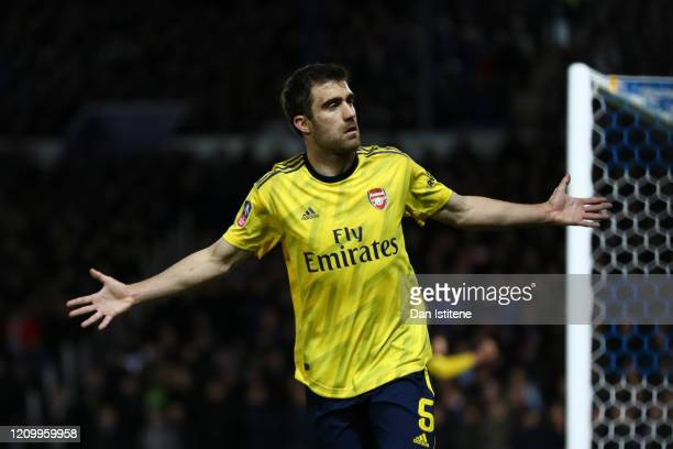 Sokratis Papastathopoulos of Arsenal celebrates after scoring his team's first goal during the FA Cup Fifth Round match between Portsmouth FC and...