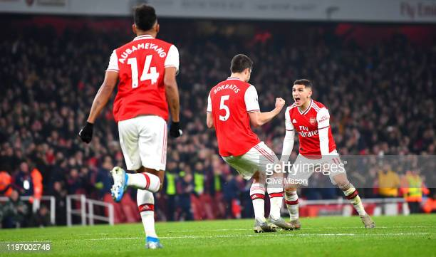 Sokratis Papastathopoulos of Arsenal celebrates with Lucas Torreira of Arsenal after scoring his team's second goal during the Premier League match...