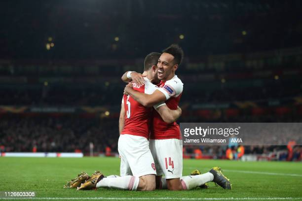 Sokratis Papastathopoulos of Arsenal celebrates with PierreEmerick Aubameyang after scoring a goal to make it 30 and 31 on Aggregate during the UEFA...