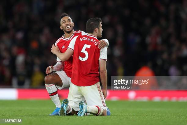 Sokratis Papastathopoulos of Arsenal celebrates with Pierre-Emerick Aubameyang of Arsenal after scoring their team's third goal which is later...