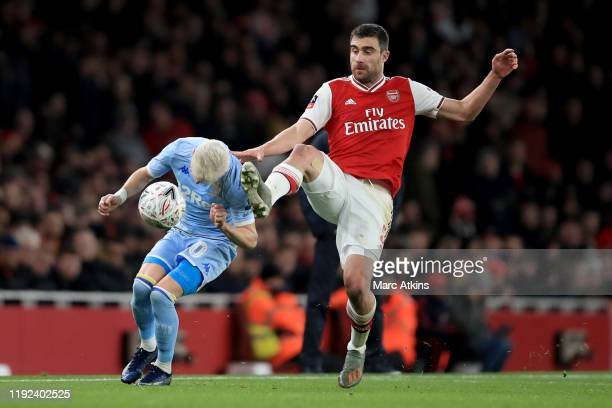 Sokratis Papastathopoulos of Arsenal in action with Ezgjan Alioski of Leeds United during the FA Cup Third Round match between Arsenal and Leeds...
