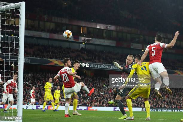 Sokratis Papastathopoulos of Arsenal scores a goal to make it 30 and 31 on Aggregate during the UEFA Europa League Round of 32 Second Leg match...