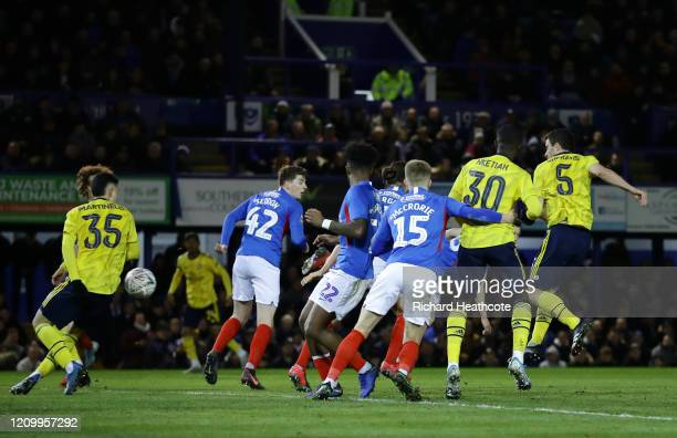 Sokratis Papastathopoulos of Arsenal scores his team's first goal during the FA Cup Fifth Round match between Portsmouth FC and Arsenal FC at Fratton...