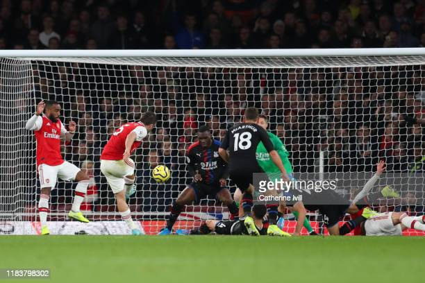 Sokratis Papastathopoulos of Arsenal scores his team's third goal which is later disallowed following a VAR check during the Premier League match...