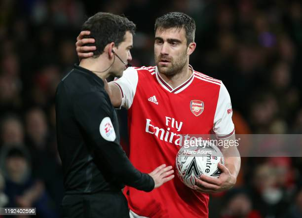 Sokratis Papastathopoulos of Arsenal speaks to the linesman during the FA Cup Third Round match between Arsenal and Leeds United at Emirates Stadium...
