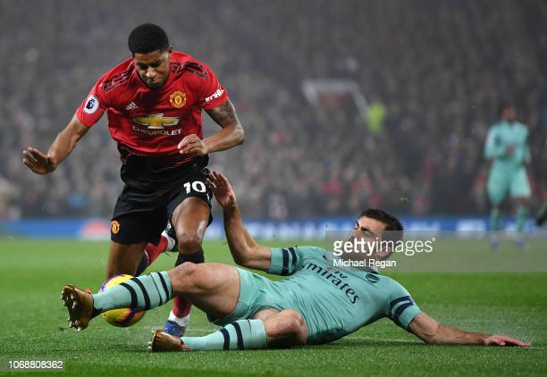 Sokratis Papastathopoulos of Arsenal tackles Marcus Rashford of Manchester United during the Premier League match between Manchester United and...