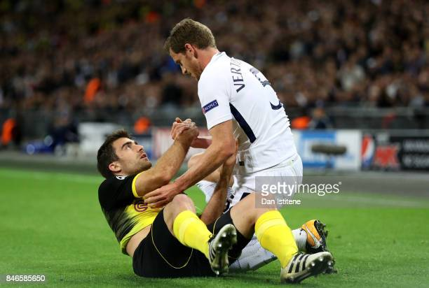 Sokratis Papastathopoulos of Borussia Dortmund and Jan Vertonghen of Tottenham Hotspur clash during the UEFA Champions League group H match between...
