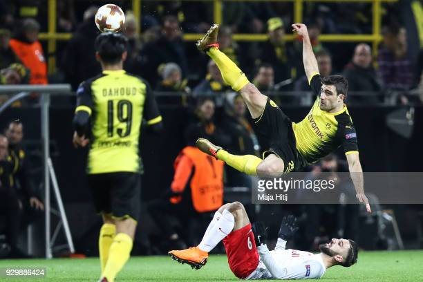 Sokratis Papastathopoulos of Borussia Dortmund and Munas Dabbur of Salzburg battle for the ball during UEFA Europa League Round of 16 match between...