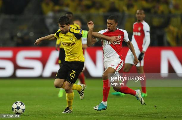Sokratis Papastathopoulos of Borussia Dortmund holds off pressure from Kylian Mbappe of AS Monaco during the UEFA Champions League Quarter Final...