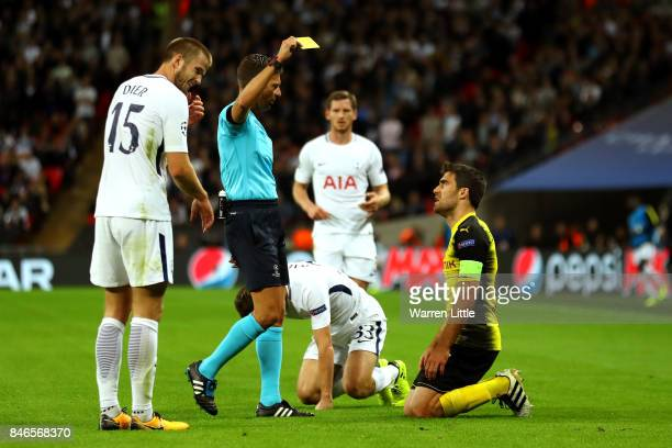 Sokratis Papastathopoulos of Borussia Dortmund is shown a yellow card by referee Gianluca Rocchi during the UEFA Champions League group H match...