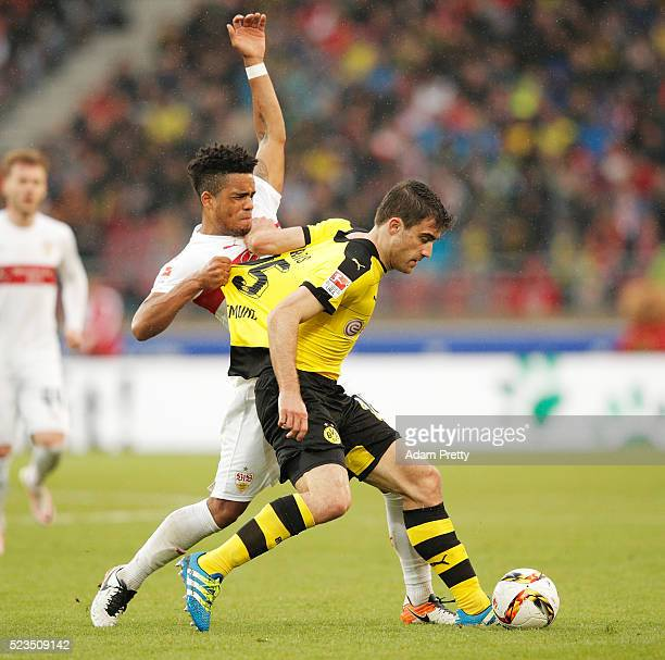 Sokratis Papastathopoulos of Borussia Dortmund tangles with Daniel Didavi of VfB Stuttgart during the Bundesliga match between VfB Stuttgart and...