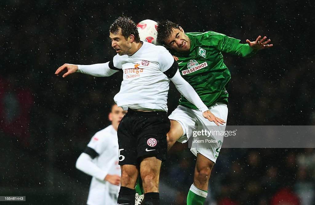 Sokratis Papastathopoulos (R) of Bremen and Andreas Ivanschitz of Mainz compete for the ball during the Bundesliga match between SV Werder Bremen and 1. FSV Mainz 05 at Weser Stadium on November 4, 2012 in Bremen, Germany.