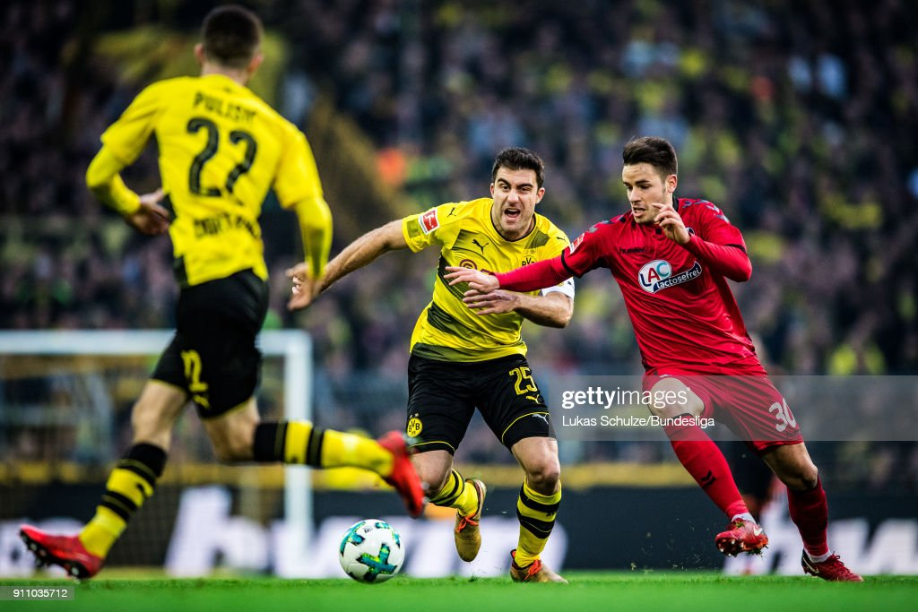 Sokratis Papastathopoulos (C) of Dortmund and Christian Guenter (R) of Freiburg in action during the Bundesliga match between Borussia Dortmund and Sport-Club Freiburg at Signal Iduna Park on January 27, 2018 in Dortmund, Germany.