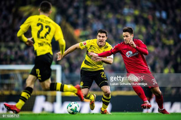 Sokratis Papastathopoulos of Dortmund and Christian Guenter of Freiburg in action during the Bundesliga match between Borussia Dortmund and SportClub...