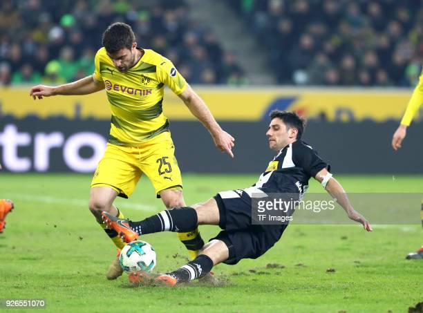 Sokratis Papastathopoulos of Dortmund and Lars Stindl of Moenchengladbach battle for the ball during the Bundesliga match between Borussia...