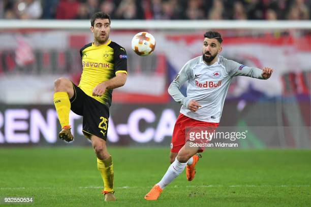 Sokratis Papastathopoulos of Dortmund and Munas Dabbur of Salzburg compete for the ball during the UEFA Europa League Round of 16 2nd leg match...